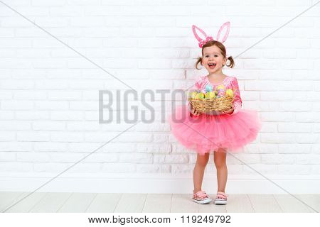Happy Child Girl In A Costume Easter Bunny Rabbit With Basket Of Eggs