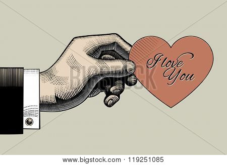 Vintage engraving drawing of hand holding a red heart with I love You lettering. Retro style valentine greeting card design. Vector illustration