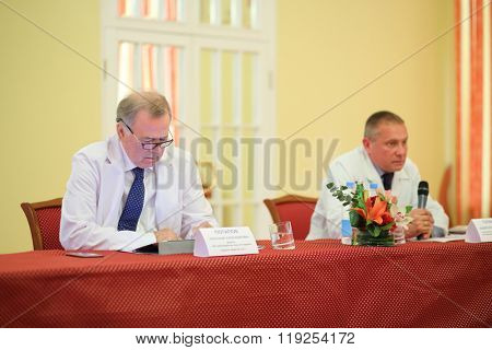MOSCOW - MAY 19, 2015: Director of Burdenko Institute of Neurosurgery Academician A.Potapov and head of Department of Radiology and Radiosurgery Professor A.Galanov at press conference for journalists