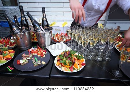 MOSCOW - APR 26, 2015: A table with glasses of champagne and treats for guests at the birthday of the magazine LF city in karaoke club Chicago