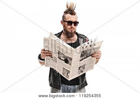 Male punk rocker reading a newspaper isolated on white background
