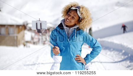 Smiling young woman posing for a photograph