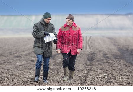 Farmers On Plowed Field