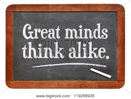 Great minds think alike proverb white chalk text on a vintage slate blackboard