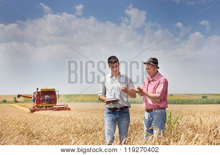 Peasant And Businessman At Harvest