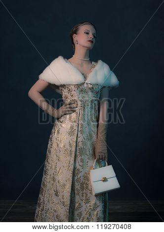 Vintage 50S Posh Fashion Woman In Gold Dress Holding Handbag.