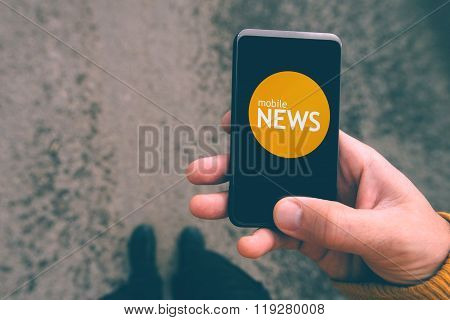Mobile News Reading On Smartphone, Man On The Street