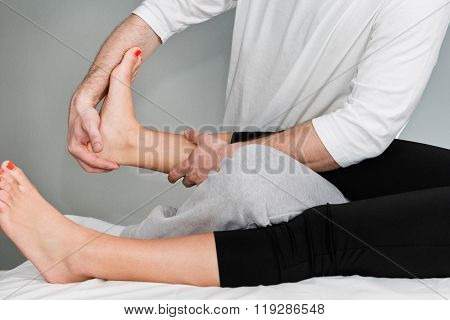 Chiropractic adjustment of patient's foot. Focus on hands and foot poster