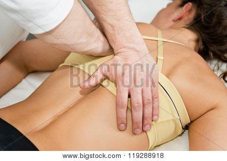 Chiropractor Treating Patient