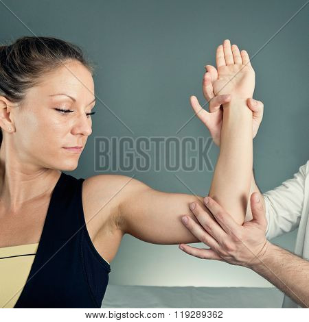 Physical Therapist Examining Patient's Arm