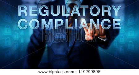Governance officer is touching REGULATORY COMPLIANCE onscreen. Business metaphor and technology concept for practices of compliance control operational transparency and IT governance. poster