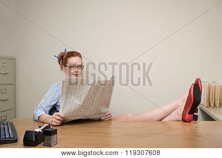 Businesswoman reading a newspaper