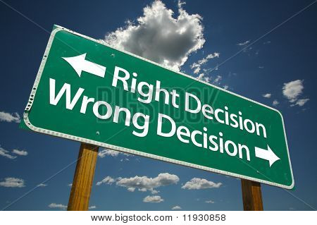 """""""Right Decision, Wrong Decision"""" Road Sign with dramatic blue sky and clouds."""