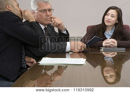 Man whispering in meeting