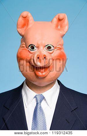 Businessman wearing a pig mask