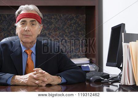 Businessman wearing a sweatband