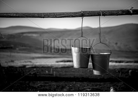 Rural Hanging metal buckets