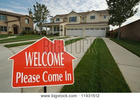 poster of Welcome, Please Come In Real Estate Sign with new home in the background.