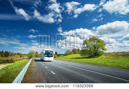 Bus on asphalt road in beautiful spring day