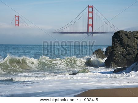 The Golden Gate Bridge in the early morning fog. San Francisco, California, United States.