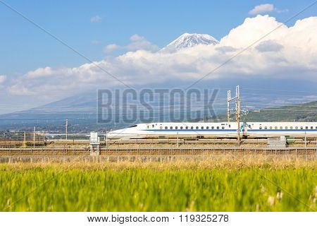SHIZUOKA Japan - DEC 1: Shinkansen bullet train with Mt. Fuji landscape in Shizuoka ,Japan on DEC 1 ,2015. Shinkansen is world's busiest high-speed railway operated by four Japan Railways companies.
