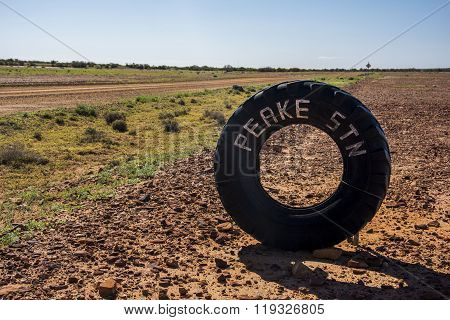 A tire on a dirt road of the Oodnadatta Track in the outback of Australia