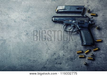 9 mm pistol gun and bullets strewn on the table