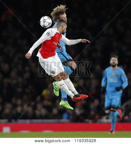 LONDON, ENGLAND - FEBRUARY 23: Francis Coquelin of Arsenal and Ivan Rakitic of Barcelona compete for the ball during the Champions League match between Arsenal and Barcelona at The Emirates Stadium