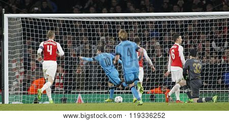 LONDON, ENGLAND - FEBRUARY 23: Lionel Messi of Barcelona celebrates scoring a goal during the Champions League match between Arsenal and Barcelona at The Emirates Stadium