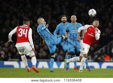 LONDON, ENGLAND - FEBRUARY 23: Andres Iniesta of Barcelona and Alex Oxlade-Chamberlain of Arsenal compete for the ball during the Champions League match between Arsenal and Barcelona