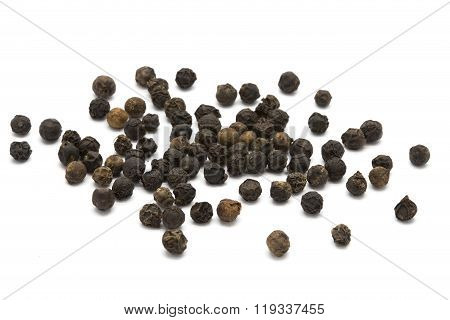 Black pepper on a white isolated background