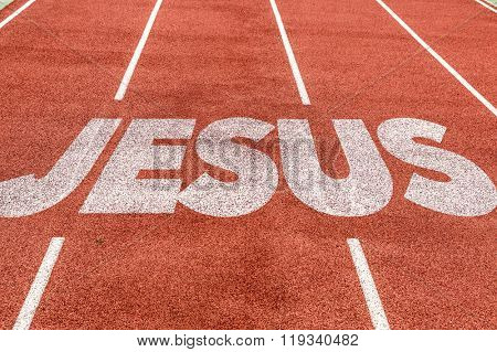 Jesus written on running track