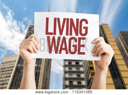 Living Wage placard with urban background