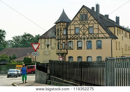 DINKELSBUHL GERMANY - AUGUST 10 2015: Street view with typical half-timbered house. Dinkelsbuhl is old Franconian town one of the best-preserved medieval urban complexes in Germany.