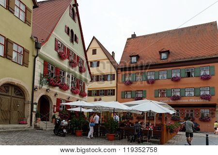 DINKELSBUHL GERMANY - AUGUST 10 2015: Traditional architecture on Wine Market st in Dinkelsbuhl one of the best-preserved medieval towns in Europe part of the famous Romantic Road tourist route.