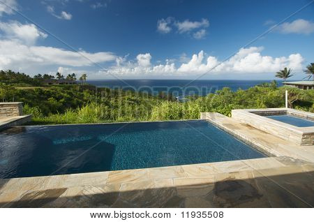 Pool and Hot Tub Overlooking the Ocean poster