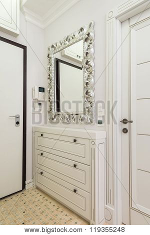 Shoe cabinet and mirror in the entryway