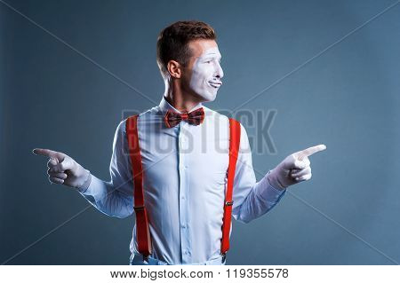 Two Funny Mimes Isolated On Gray Background