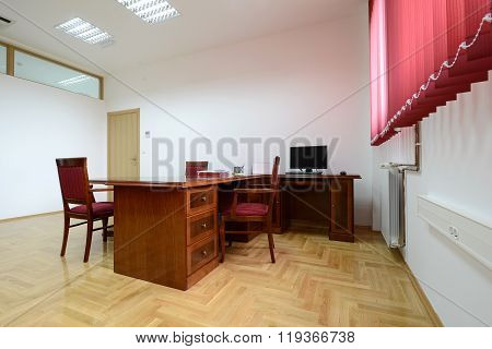 Modern office interior - director's office with a place for meetings