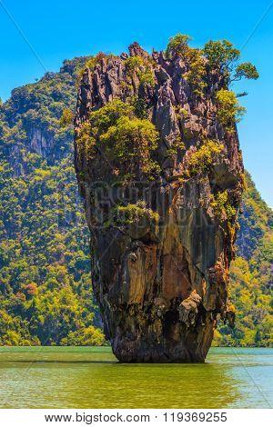 Calm and warm sea and picturesque quaint island. The tourist season in Thailand. James Bond Island