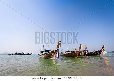 Anchored Wooden Long Tail Boats At Sea