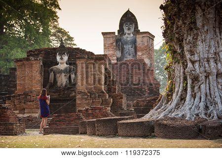 Tourist women take a photos at Sukhothai historical park, Mahathat Temple. Sukhothai ,Thailand