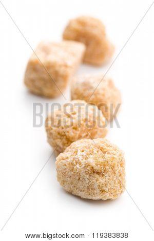 unrefined cane sugar on white background