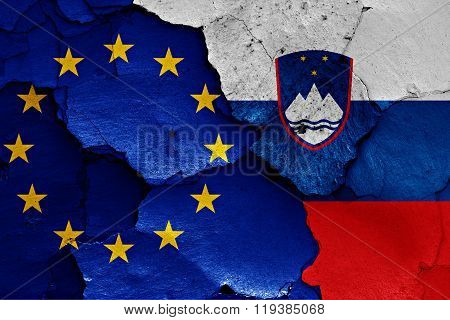 Flags Of Eu And Slovenia Painted On Cracked Wall