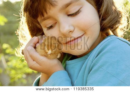 Affectionate Girl Holding Chicken In Hands Like A Treasure