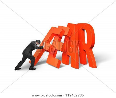 Businessman Pushing Domino Of Red Fear Word Falling