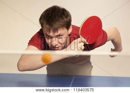 Young man playing ping pong