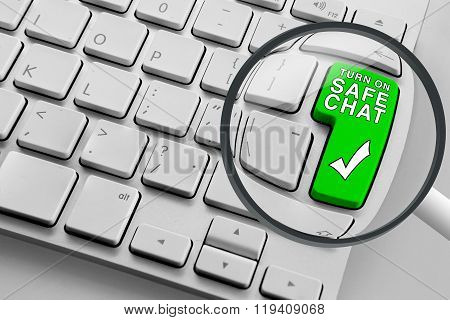 Computer keyboard with green safe chat button and magnifying glass