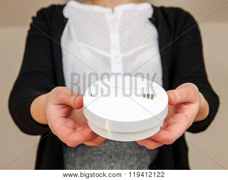 Woman Holding White Smoke Detector