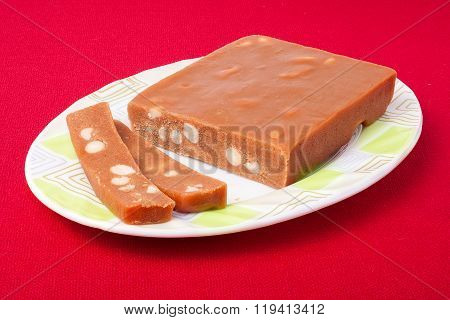 Pieces of sherbet isolated on red background